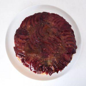 plum vegan weed cake on white background