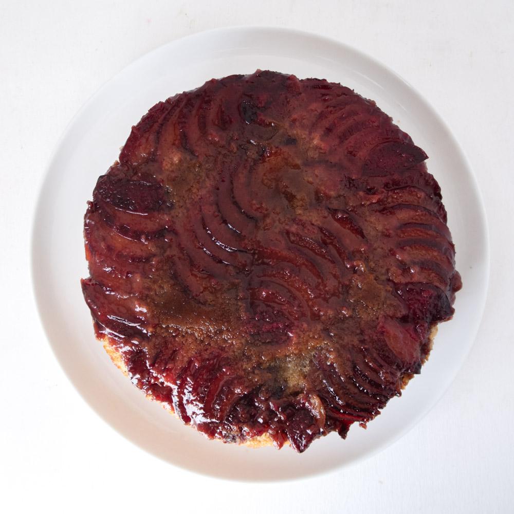 plum vegan pot cake on white background